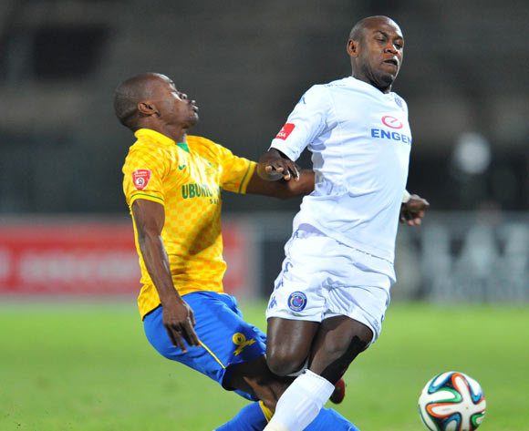 Sibusiso Khumalo of Supersport United challenged by Asavela Mbekile of Mamelodi Sundowns during the Absa Premiership 2014/15 match between Supersport United and Mamelodi Sundownsd at the Lucas Moripe Stadium in Pretoria, South Africa on May 06, 2015
