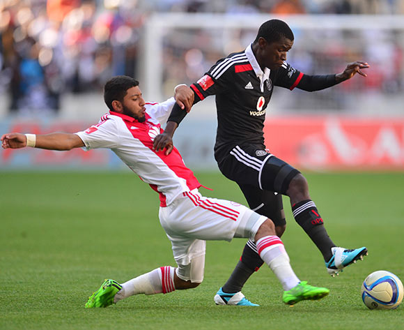 Sifiso Myeni of Orlando Pirates gets away from Riyaad Norodien of Ajax Cape Town during the Absa Premiership 2014/15 football match between Ajax Cape Town and Orlando Pirates at Cape Town Stadium, Cape Town on 9 May 2015 ©Chris Ricco/BackpagePix