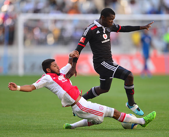 Sifiso Myeni of Orlando Pirates tackled by Riyaad Norodien of Ajax Cape Town during the Absa Premiership 2014/15 football match between Ajax Cape Town and Orlando Pirates at Cape Town Stadium, Cape Town on 9 May 2015 ©Chris Ricco/BackpagePix