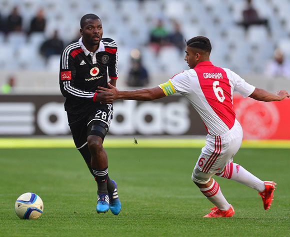 Rooi Mahamutsa of Orlando Pirates gets away from Travis Graham of Ajax Cape Town during the Absa Premiership 2014/15 football match between Ajax Cape Town and Orlando Pirates at Cape Town Stadium, Cape Town on 9 May 2015 ©Chris Ricco/BackpagePix