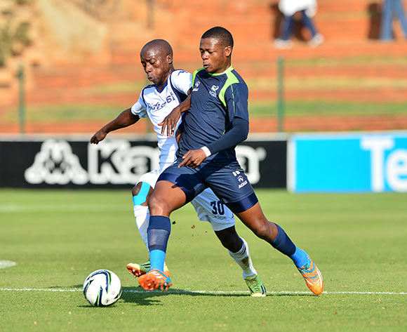 Ndumiso Mabena of Platinum Stars clears ball from Ben Motshwari of Bidvest Wits during the 2014/15 Absa Premiership football match between Bidvest Wits and Platinum Stars at Bidvest Stadium 09 May 2015 ©Gavin Barker/BackpagePix
