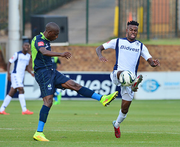 Jabulani Shongwe of Bidvest Wits clears ball from Tintswalo Tshabalala of Platinum Stars during the 2014/15 Absa Premiership football match between Bidvest Wits and Platinum Stars at Bidvest Stadium 09 May 2015 ©Gavin Barker/BackpagePix