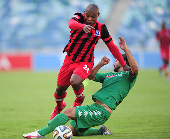 Marc van Heerden of AmaZulu  slides in for the tackle on Mondli Cele of Maritzburg United FC during the Absa Premiership match between AmaZulu and Maritzburg United FC at the Moses Mabhida Stadium in Durban, South Africa on May 09, 2015 ©Gerhard Duraan/BackpagePix