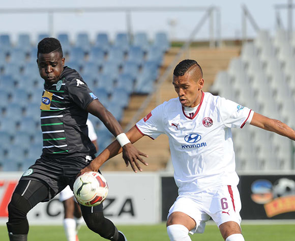 Gabadinhno Mhango of Bloemfontein Celtic  is challenged by Ashraf Hendricks of Moroka Swallows during the Absa Premiership match between Moroka Swallows and Bloemfontein Celtic on 09 May 2015 at Dobsonville Stadium Pic Sydney Mahlangu/BackpagePix