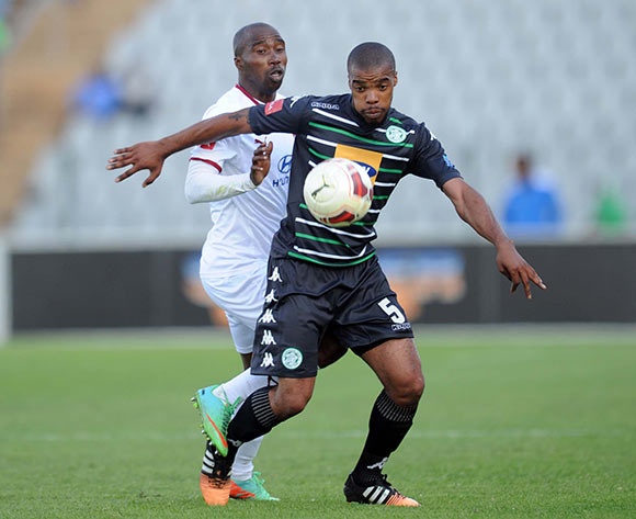 Siyabonga Nomvethe of Moroka Swallows challenges Wandisile Letlabika of Bloemfontein Celtic  during the Absa Premiership match between Moroka Swallows and Bloemfontein Celtic on 09 May 2015 at Dobsonville Stadium Pic Sydney Mahlangu/BackpagePix