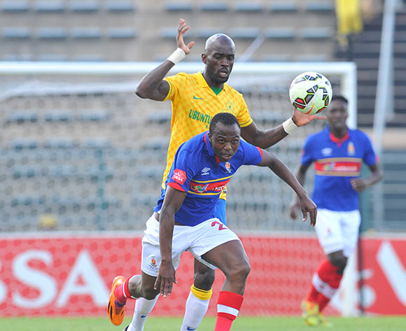 Khethukuthula Zwane of University Pretoria challenged by Anthony Laffor of Mamelodi Sundowns during the Absa Premiership 2014/15 match between Mamelodi Sundowns and University of Pretoria at the Lucas Moripe Stadium in Pretoria, South Africa on May 09, 2015 ©Samuel Shivambu/BackpagePix