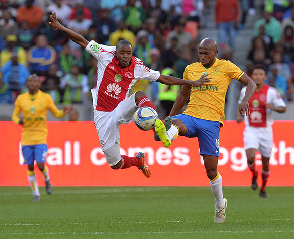 Bantu Mzwakali of Ajax Cape Town battles for the ball with Ramahlwe Mphahlele of Mamelodi Sundowns during the Nedbank Cup Final Football Match between Mamelodi Sundowns and Ajax Cape Town at Nelson Mandela Bay Stadium, Port Elizabeth on 16 May 2015 ©Chris Ricco/BackpagePix
