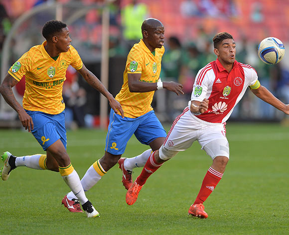 Travis Graham of Ajax Cape Town gets away from Hlompho Kekana of Mamelodi Sundowns and Bongani Zungu of Mamelodi Sundowns during the Nedbank Cup Final Football Match between Mamelodi Sundowns and Ajax Cape Town at Nelson Mandela Bay Stadium, Port Elizabeth on 16 May 2015 ©Chris Ricco/BackpagePix