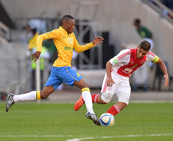 Travis Graham of Ajax Cape Town tackles Khama Billiat of Mamelodi Sundowns during the Nedbank Cup Final Football Match between Mamelodi Sundowns and Ajax Cape Town at Nelson Mandela Bay Stadium, Port Elizabeth on 16 May 2015 ©Chris Ricco/BackpagePix