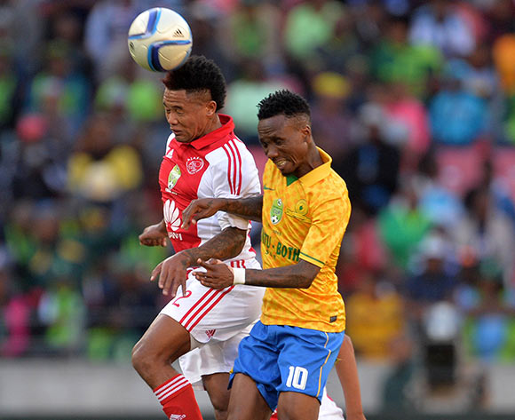 Granwald Scott of Ajax Cape Town battles for the ball with Teko Modise of Mamelodi Sundowns during the Nedbank Cup Final Football Match between Mamelodi Sundowns and Ajax Cape Town at Nelson Mandela Bay Stadium, Port Elizabeth on 16 May 2015 ©Chris Ricco/BackpagePix