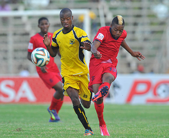 Pentjie Zulu of Jomo Cosmos challenged by Ivan Mahangwahaya of Black Leopards during the PSL promotion play-off match between Black Leopards and Jomo Cosmos at the Thohoyandou Stadium in Limpopo, South Africa on May 17, 2015 ©Samuel Shivambu/BackpagePix