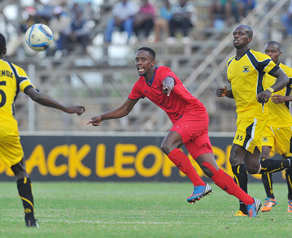 Linda Mntambo of Jomo Cosmos challenged by Harry Nyirenda of Black Leopards during the PSL promotion play-off match between Black Leopards and Jomo Cosmos at the Thohoyandou Stadium in Limpopo, South Africa on May 17, 2015 ©Samuel Shivambu/BackpagePix