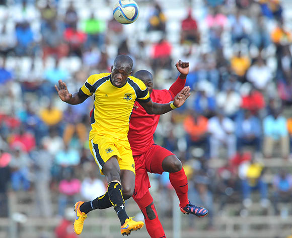 Ruggert Nyundu of Black Leopards challenged by Pilot Mthembu of Jomo Cosmos during the PSL promotion play-off match between Black Leopards and Jomo Cosmos at the Thohoyandou Stadium in Limpopo, South Africa on May 17, 2015 ©Samuel Shivambu/BackpagePix