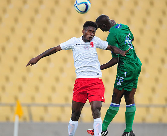 Sarivahy Vombola of Madagascar battles with Lerotholi Nkau of Lesotho during the 2015 Cosafa Cup match between Lesotho and Madagasca at the Royal Bafokeng Stadium, Rustenburg on the 18 May 2015  ©Muzi Ntombela/BackpagePix