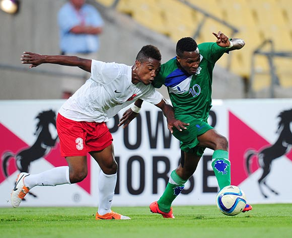 Mabuti Potloane of Lesotho challenged by Fenolahy Zenith of Madagascar during the 2015 Cosafa Cup match between Lesotho and Madagasca at the Royal Bafokeng Stadium, Rustenburg on the 18 May 2015  ©Muzi Ntombela/BackpagePix