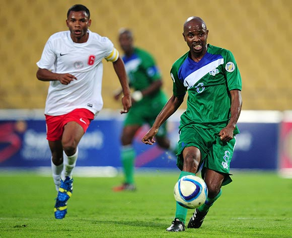 Mocheku Moletsane of Lesotho challenged by Robeson Michael of Madagascar during the 2015 Cosafa Cup match between Lesotho and Madagasca at the Royal Bafokeng Stadium, Rustenburg on the 18 May 2015  ©Muzi Ntombela/BackpagePix