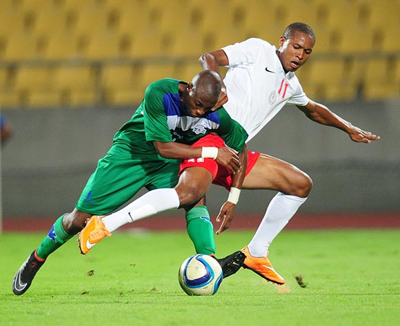 Jeremea Kamela of Lesotho challenged by Rakotoharimalala Martin of Madagascar during the 2015 Cosafa Cup match between Lesotho and Madagasca at the Royal Bafokeng Stadium, Rustenburg on the 18 May 2015  ©Muzi Ntombela/BackpagePix