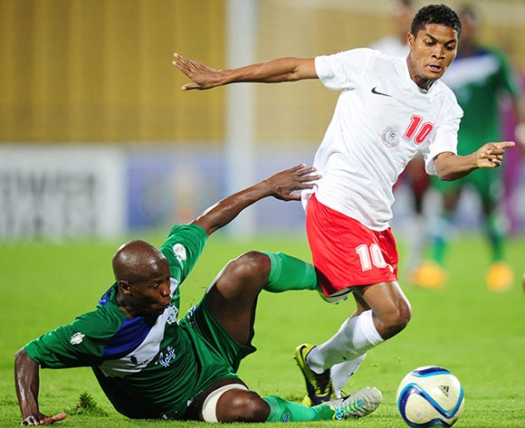 Lantonirina Rabehasinmbola Lanto of Madagascar battles with Bokang Mothoana of Lesotho during the 2015 Cosafa Cup match between Lesotho and Madagasca at the Royal Bafokeng Stadium, Rustenburg on the 18 May 2015  ©Muzi Ntombela/BackpagePix
