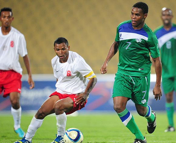 Lekhaya Emmanuel of Lesotho challenged by Robeson Michael of Madagascar during the 2015 Cosafa Cup match between Lesotho and Madagasca at the Royal Bafokeng Stadium, Rustenburg on the 18 May 2015  ©Muzi Ntombela/BackpagePix