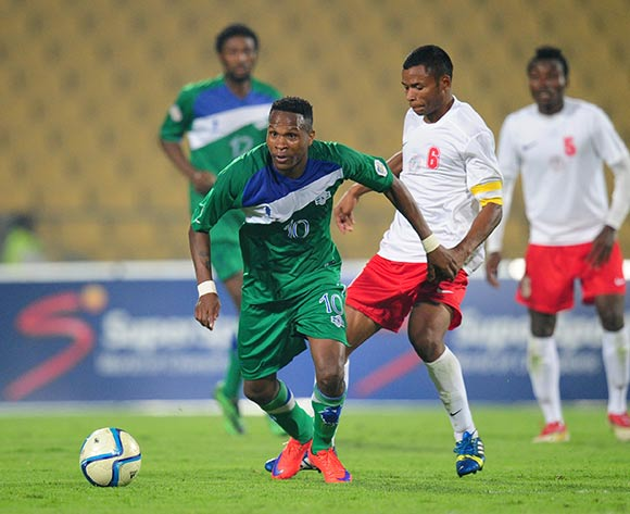 Mabuti Potloane of Lesotho challenged by Robeson Michael of Madagascar during the 2015 Cosafa Cup match between Lesotho and Madagasca at the Royal Bafokeng Stadium, Rustenburg on the 18 May 2015  ©Muzi Ntombela/BackpagePix