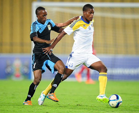 Njabulo Ndlovu of Swaziland challenged by Said Juma of Tanzania during the 2015 Cosafa Cup match between Tanzania and Swaziland at the Royal Bafokeng Stadium, Rustenburg on the 18 May 2015  ©Muzi Ntombela/BackpagePix