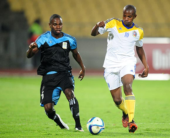 Zwell Nxumalo of Swaziland challenged by Shomari Kapombe of Tanzania during the 2015 Cosafa Cup match between Tanzania and Swaziland at the Royal Bafokeng Stadium, Rustenburg on the 18 May 2015  ©Muzi Ntombela/BackpagePix