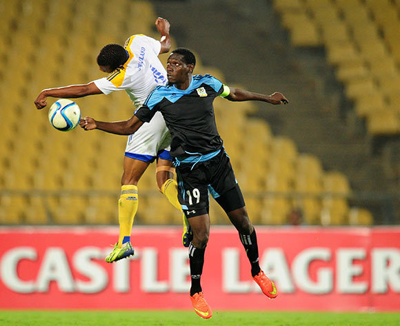John Bocco of Tanzania battles with Siyabonga Mdluli of Swaziland during the 2015 Cosafa Cup match between Tanzania and Swaziland at the Royal Bafokeng Stadium, Rustenburg on the 18 May 2015  ©Muzi Ntombela/BackpagePix