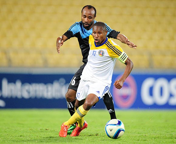 Tony Tsabedze of Swaziland challenged by Mwinyi Kazimoto of Tanzania during the 2015 Cosafa Cup match between Tanzania and Swaziland at the Royal Bafokeng Stadium, Rustenburg on the 18 May 2015  ©Muzi Ntombela/BackpagePix