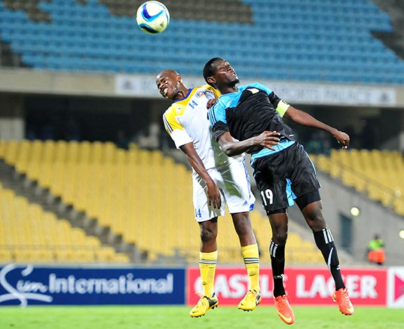 John Bocco of Tanzania battles with Machawe Dlamini of Swaziland during the 2015 Cosafa Cup match between Tanzania and Swaziland at the Royal Bafokeng Stadium, Rustenburg on the 18 May 2015  ©Muzi Ntombela/BackpagePix