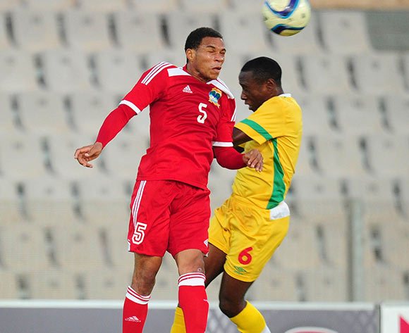 Jones Joubert of Seychelles battles with Hardlife Zvirekwi of Zimbabwe during the 2015 Cosafa Cup match between Seychelles and Zimbabwe at the Moruleng Stadium, Rustenburg on the 19 May 2015  ©Muzi Ntombela/BackpagePix