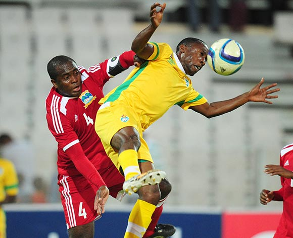 Hardlife Zvirekwi of Zimbabwe battles with Ronny Steven Hoareau of Seychelles during the 2015 Cosafa Cup match between Seychelles and Zimbabwe at the Moruleng Stadium, Rustenburg on the 19 May 2015  ©Muzi Ntombela/BackpagePix