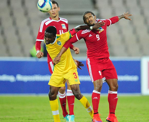 Danny Phiri of Zimbabwe battles with Gervais Waye-Hive of Seychelles during the 2015 Cosafa Cup match between Seychelles and Zimbabwe at the Moruleng Stadium, Rustenburg on the 19 May 2015  ©Muzi Ntombela/BackpagePix