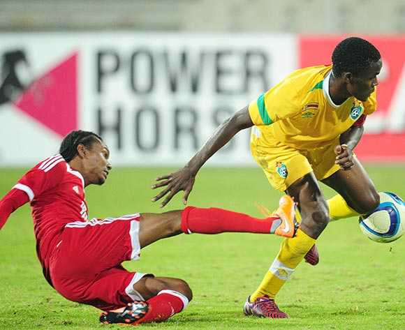 Danny Phiri of Zimbabwe battles with Achille Henriette of Seychelles during the 2015 Cosafa Cup match between Seychelles and Zimbabwe at the Moruleng Stadium, Rustenburg on the 19 May 2015  ©Muzi Ntombela/BackpagePix
