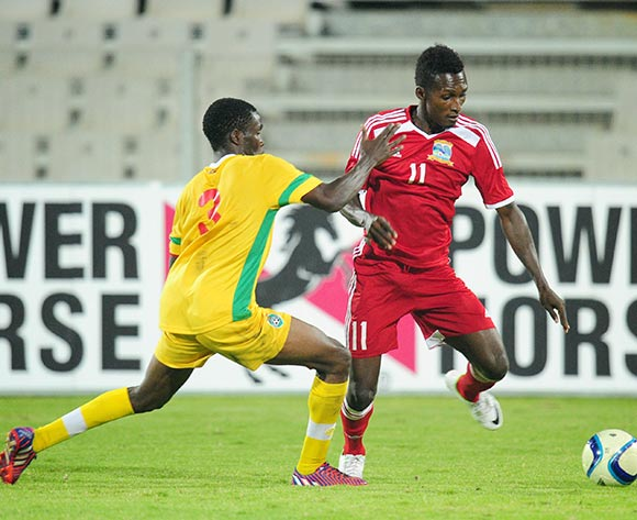 Renick Esther of Seychelles challenged by Danny Phiri of Zimbabwe during the 2015 Cosafa Cup match between Seychelles and Zimbabwe at the Moruleng Stadium, Rustenburg on the 19 May 2015  ©Muzi Ntombela/BackpagePix