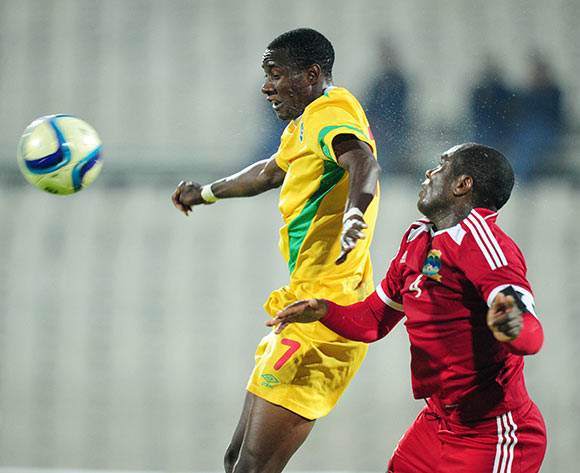 Evans Rusike of Zimbabwe challenged by Ronny Steven Hoareau of Seychelles during the 2015 Cosafa Cup match between Seychelles and Zimbabwe at the Moruleng Stadium, Rustenburg on the 19 May 2015  ©Muzi Ntombela/BackpagePix
