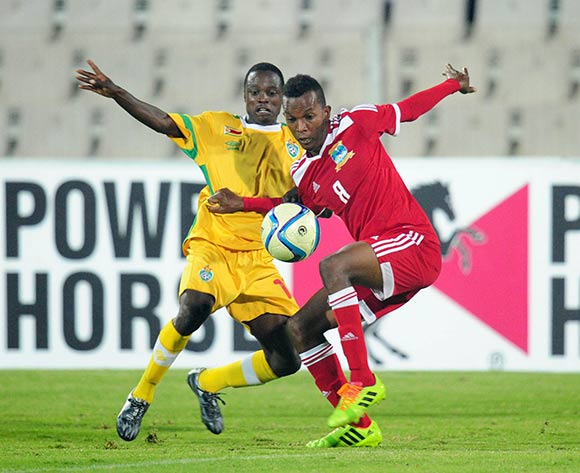 Colin Esther of Seychelles battles with Ronald Chitiyo of Zimbabwe