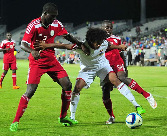 Joseph Kevin Perticots of Mauritius challenged by Denzil Haoseb and Petrus Shitembi of Namibia during the 2015 Cosafa Cup match between Mauritius and Namibia at the Moruleng Stadium, Rustenburg on the 19 May 2015  ©Muzi Ntombela/BackpagePix