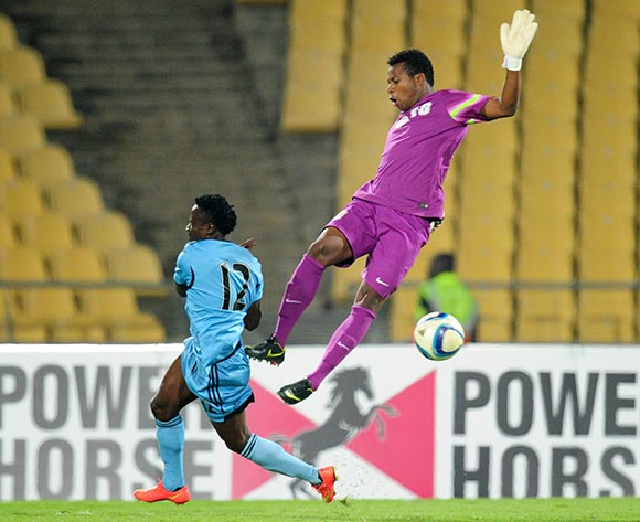 Randrianasy Florent of Madagascar battles with Saimon Happygod Msuva of Tanzania during the 2015 Cosafa Cup match between Madagascar and Tanzania at the Royal Bafokeng Stadium, Rustenburg on the 20 May 2015  ©Muzi Ntombela/BackpagePix