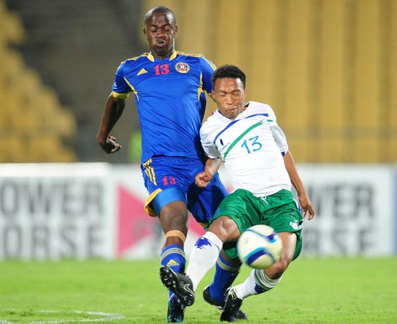 Mohau Rammoneng of Lesotho challenged by Siboniso Malambe of Swaziland during the 2015 Cosafa Cup match between Lesotho and Swaziland at the Royal Bafokeng Stadium, Rustenburg on the 20 May 2015