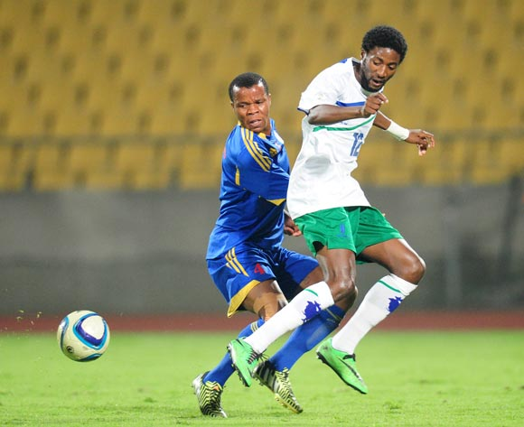 Masoabi Nkoto of Lesotho challenged by Siyabonga Mdluli of Swaziland during the 2015 Cosafa Cup match between Lesotho and Swaziland at the Royal Bafokeng Stadium, Rustenburg on the 20 May 2015