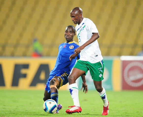 Thabiso Mohapi of Lesotho challenged by Sanele Mkhweli of Swaziland during the 2015 Cosafa Cup match between Lesotho and Swaziland at the Royal Bafokeng Stadium, Rustenburg on the 20 May 2015