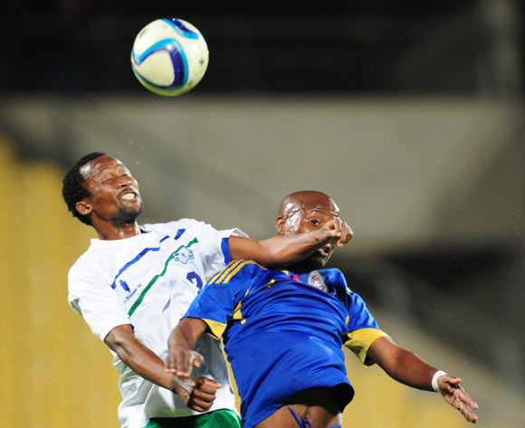 Mxolisi Lukhele of Swaziland battles with Thabo Masualle of Lesotho during the 2015 Cosafa Cup match between Lesotho and Swaziland at the Royal Bafokeng Stadium, Rustenburg on the 20 May 2015