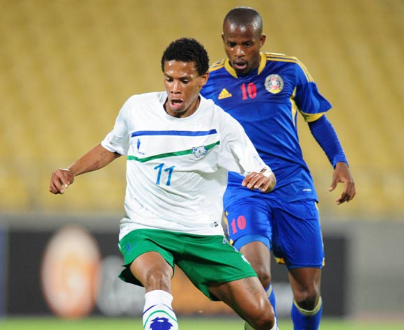 Tsoanelo Koetle of Lesotho challenged by Zweli Nxumalo of Swaziland during the 2015 Cosafa Cup match between Lesotho and Swaziland at the Royal Bafokeng Stadium, Rustenburg on the 20 May 2015