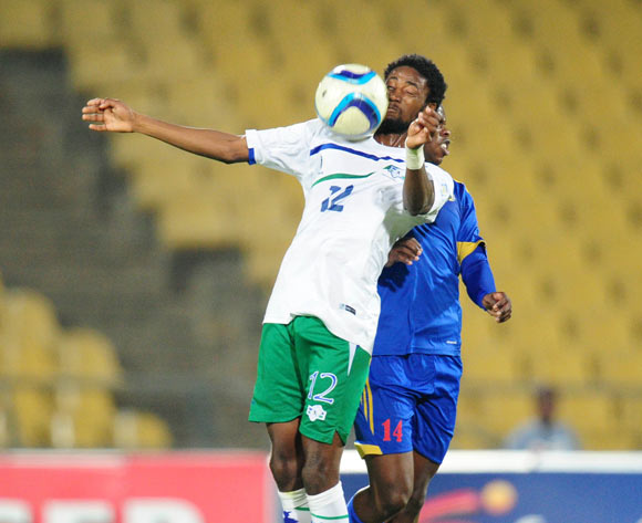 Masoabi Nkoto of Lesotho challenged by Machawe Dlamini of Swaziland during the 2015 Cosafa Cup match between Lesotho and Swaziland at the Royal Bafokeng Stadium, Rustenburg on the 20 May 2015