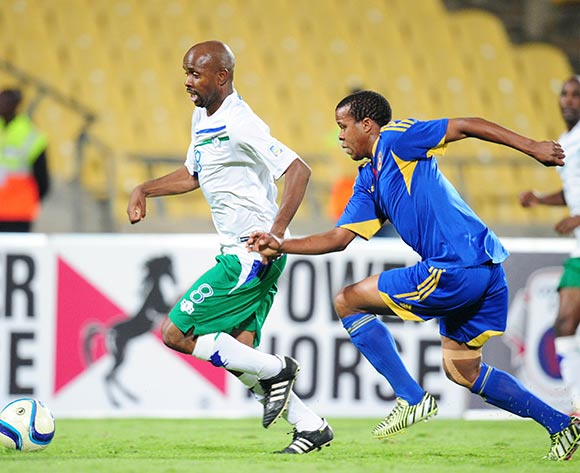 Mocheku Moletsane of Lesotho challenged by Siyabonga Mdluli of Swaziland during the 2015 Cosafa Cup match between Lesotho and Swaziland at the Royal Bafokeng Stadium, Rustenburg on the 20 May 2015  ©Muzi Ntombela/BackpagePix