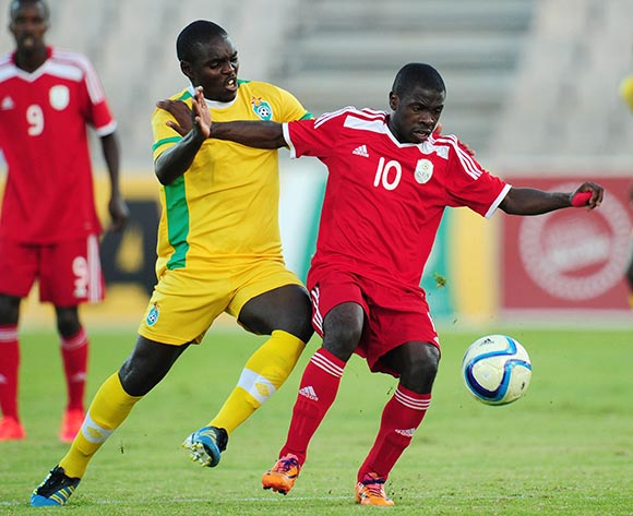 Wangu Gome of Namibia challenged by Thomas Magorimbo of Zimbabwe during the 2015 Cosafa Cup match between Namibia and Zimbabwe at the Moruleng Stadium, Rustenburg on the 21 May 2015  ©Muzi Ntombela/BackpagePix