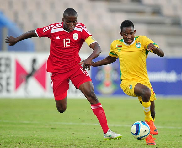 Talent Chawapiwa of Zimbabwe challenged by Ronald Ketjijere of Namibia during the 2015 Cosafa Cup match between Namibia and Zimbabwe at the Moruleng Stadium, Rustenburg on the 21 May 2015  ©Muzi Ntombela/BackpagePix