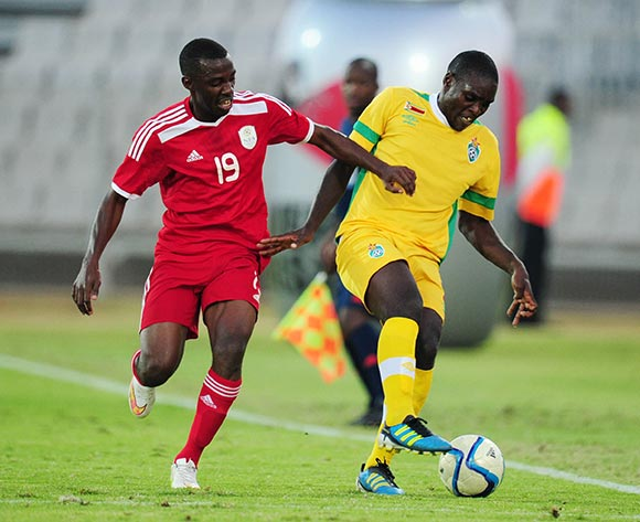 Thomas Magorimbo of Zimbabwe challenged by Petrus Shitembi of Namibia during the 2015 Cosafa Cup match between Namibia and Zimbabwe at the Moruleng Stadium, Rustenburg on the 21 May 2015  ©Muzi Ntombela/BackpagePix