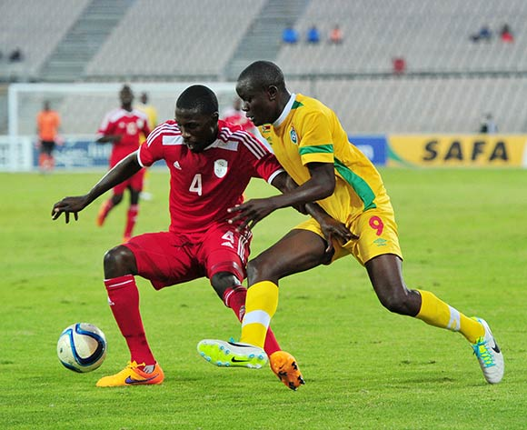 Willem Mwedihanga of Namibia battles with Prichard Mpelele of Zimbabwe during the 2015 Cosafa Cup match between Namibia and Zimbabwe at the Moruleng Stadium, Rustenburg on the 21 May 2015  ©Muzi Ntombela/BackpagePix