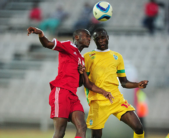 Peter Shalulile of Namibia battles with Carlos Rusere of Zimbabwe during the 2015 Cosafa Cup match between Namibia and Zimbabwe at the Moruleng Stadium, Rustenburg on the 21 May 2015  ©Muzi Ntombela/BackpagePix